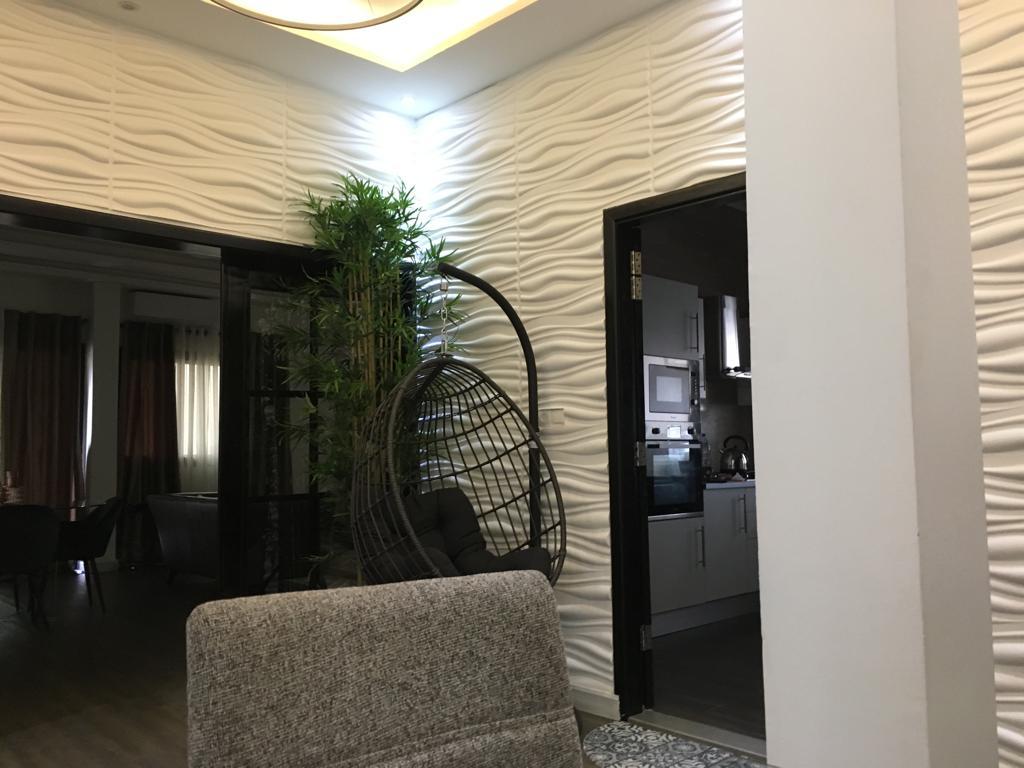 Décoration-maison-Sénégal-Panneaux-3D-salon-Dakar-Thiès-Saint-Louis-Faux-Plafond-design-Sensys-Afric Panneaux 3D