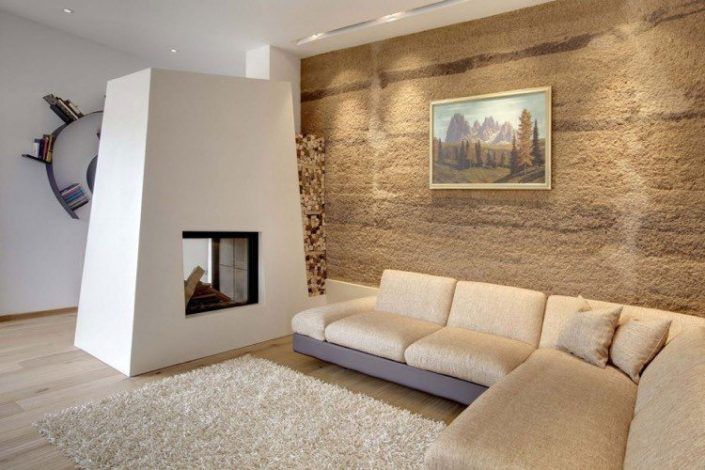 mur-de-pierre-brute-cheminee-moderne-canape-angle-beige-705x470 Pierre Naturelle
